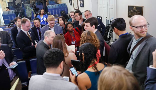 Reporters talk after failing to get access to an off camera briefing with White House Press Secretary Sean Spicer and a small group of reporters instead of the normal on camera briefing at the White House on February 24, 2017, in Washington, DC.