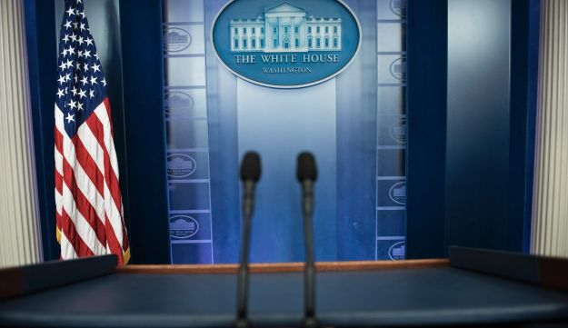 An empty podium is seen as an off camera briefing is held with a small group of reporters and White House Press Secretary Sean Spicer instead of the normal on camera briefing in the White House February 24, 2017 in Washington, DC.