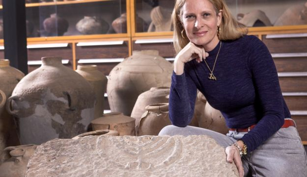 Dr. Katya Cytryn-Silverman next to the engraved rock.