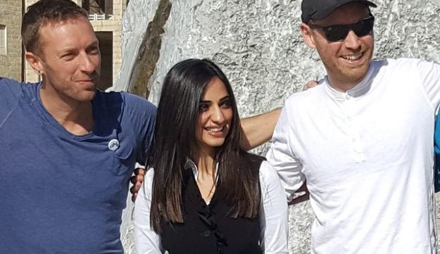 Coldplay's Chris Martin and Jonny Buckland pose in the Palestinian city of Rawabi.