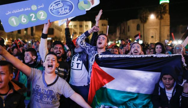Palestinians celebrate in the biblical town of Bethlehem as they cheer for their countryman and Arab Idol contestant Yaacoub Shahin, who won the 2017 edition of the pan-Arab song contest on February 25, 2017.