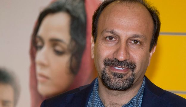 """FILE - In this Oct. 10, 2016 file photo, Iranian director Asghar Farhadi poses for a photo during the premiere of his film, """"The Salesman, in Paris."""