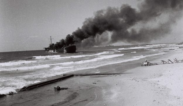 The burning of the Altalena arms ship off the coast of Tel Aviv, after being shelled by the nascent Israeli army, June 22, 1948. Historian Saul Friedlander was one of the passengers.