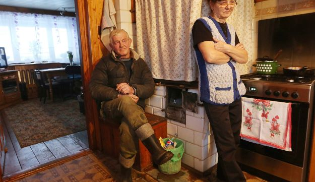 Barbara, right, and Witold Pogorzelski talk to the Associated Press in the kitchen of their home in Kobylin-Borzymy in eastern Poland, Feb. 13, 2017.