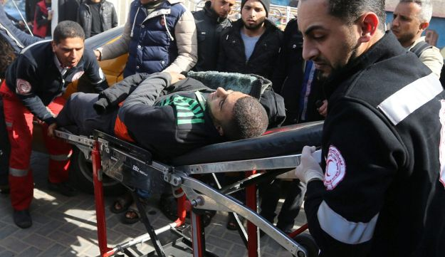 A wounded Palestinian is brought into a hospital following what police said was an Israeli air strike in Rafah in the southern Gaza Strip February 27, 2017.