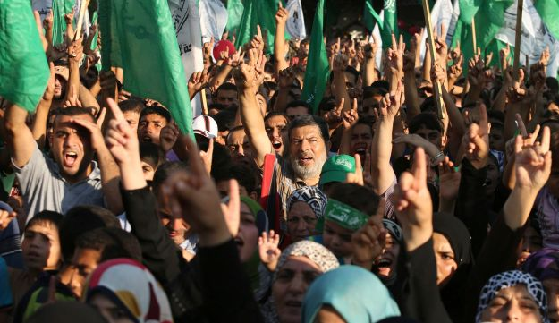 Palestinian Hamas supporters celebrate what they said was a victory over Israel, in Gaza City, on August 27, 2014, the day after a cease-fire was declared.