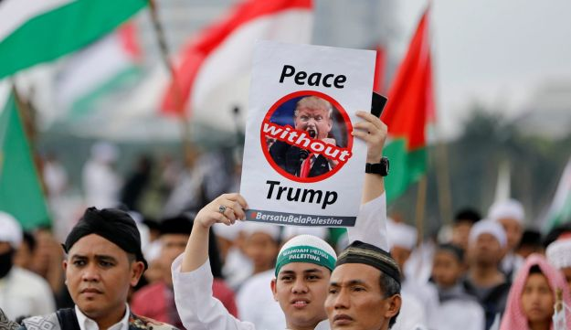 A protester holds a sign during a rally to condemn U.S. President Donald Trumps's decision to recognize Jerusalem as Israel's capital, Jakarta, Indonesia, December 17, 2017