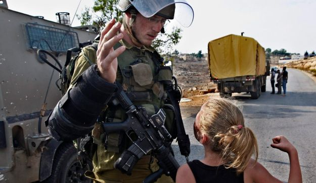 November 2, 2012: Ahed Tamimi tries to punch an Israeli soldier near Ramallah.