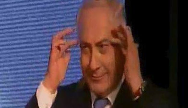 Prime Minister Benjamin Netanyahu mocking the eyebrows of Channel 2 police reporter Moshe Nussbaum at a Likud event on November 19, 2017.