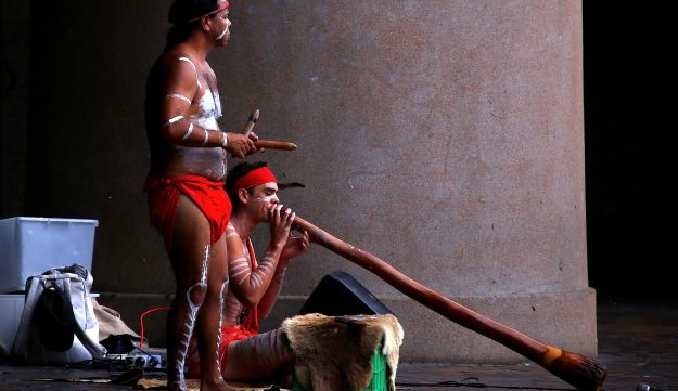Aboriginal performers play traditional musical instruments, the didgeridoo and music sticks, at Sydney's Circular Quay, Australia, March 8, 2017.