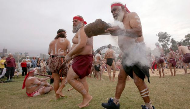 Aborigines perform the traditional smoking ceremony, as part of Australia Day celebration in Sydney, Thursday, Jan. 26, 2017.