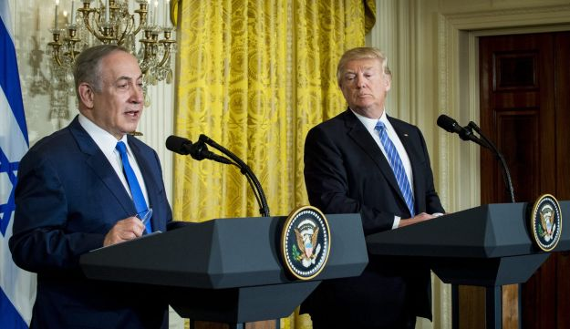 U.S. President Donald Trump looks over at Prime Minister Benjamin Netanyahu at a joint press conference in Washington, February 15, 2017.