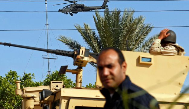 Military forces and helicopters secure an area in North Sinai, Egypt, December 1, 2017.