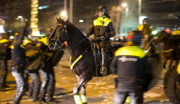 Dutch riot police battle pro Erdogan demonstrators after riots broke out at the Turkish consulate in Rotterdam, Netherlands, Sunday, March 12, 2017.