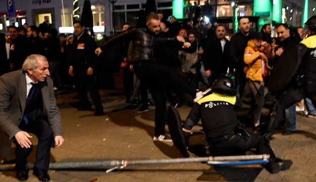 Riot police clash with demonstrators in the streets near the Turkish consulate in Rotterdam, Netherlands March 12, 2017.