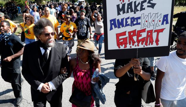 Cornel West walks in a march against racism and injustice before the Republican National Convention in Cleveland, Ohio. July 16, 2016
