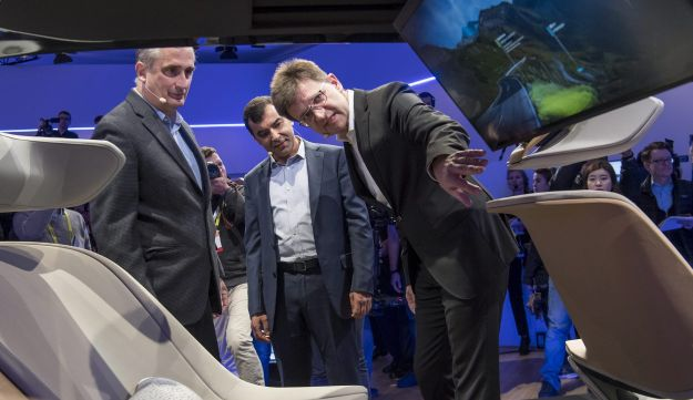 Intel CEO Brian Krzanich (L), Mobileye CTO Amnon Shashua and Klaus Froehlich, member of the BMW board, view the BMWi Inside Future concept car in Las Vegas, Nevada, January 4, 2017.
