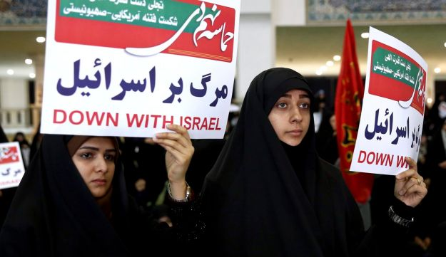 Iranian hard-liner protesters hold anti-Israel placards at a Tehran rally to support the country's supreme leader as spontaneous protests roiled major cities in Iran. Dec. 30, 2017