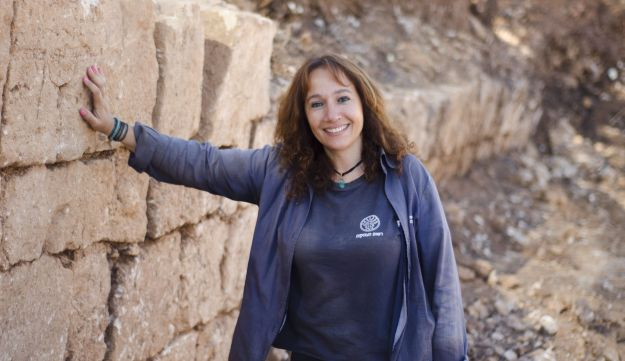 Annette Landes-Nager, excavation director on behalf of the Israel Antiquities Authority, near the collapse of the wall in which the coins were discovered