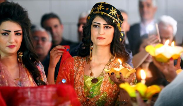 Syrian-Kurdish women model traditional Kurdish attire during a fashion show in Qamishli, Syria, March 10, 2017.
