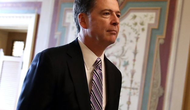 FBI Director James Comey leaves a closed door meeting with Senators at the U.S. Capitol on March 15, 2017 in Washington, D.C.