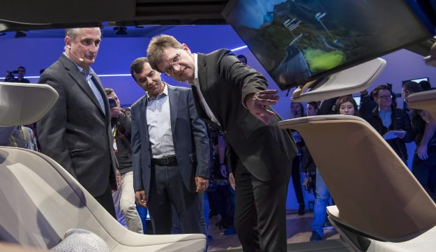 Brian Krzanich, chief executive officer of Intel Corp., from left, Amnon Shahua, chairman and chief technology officer of Mobileye, and Klaus Froehlich, member of the management board at BMW, view the BMWi Inside Future concept vehicle during a press event at the 2017 Consumer Electronics Show (CES) in Las Vegas, January 4, 2017.