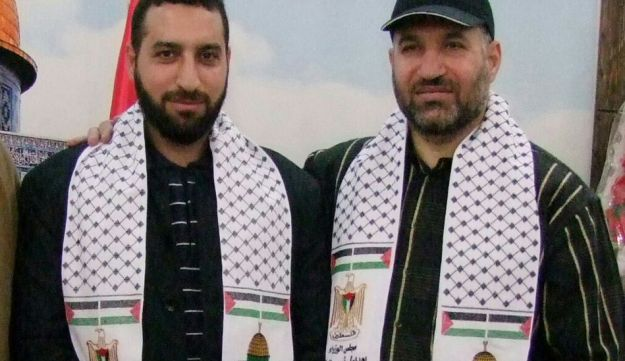 Fuqaha, right, with Ahmed Jabari, a leader of Hamas' military wing who was killed in an IDF strike in 2012.