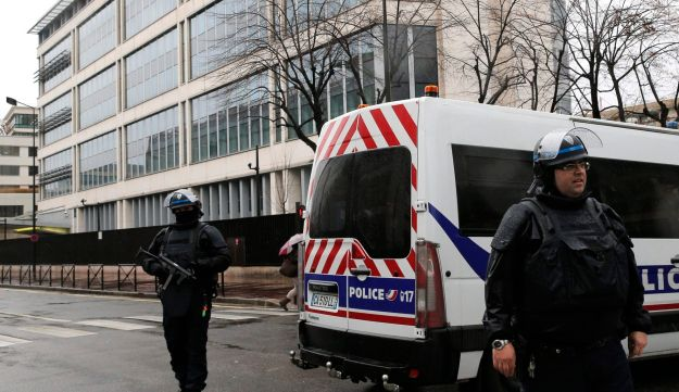 Police officers guard the General Directorate for Internal Security headquarters in Levallois Perret, outside Paris, 2015.