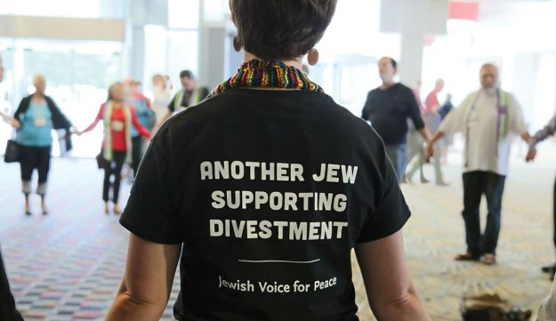 JVP members at the Presbyterian Church's General Assembly when the church voted to divest from companies complicit in the occupation in 2012.