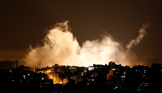 Smoke from flares rises in the sky in Gaza City, in the northern Gaza Strip, Thursday, July 17, 2014