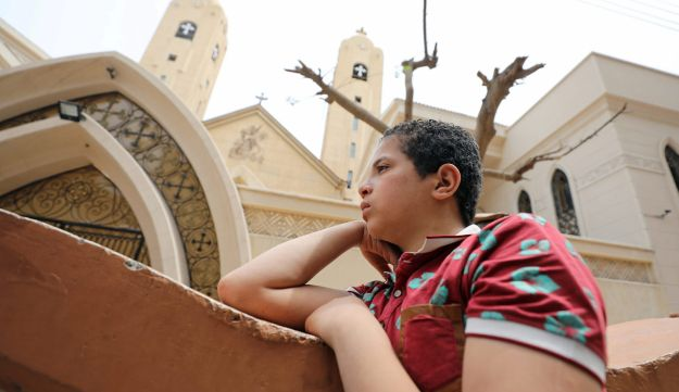 A relative of one of the victims stands near the Coptic church that was bombed on Sunday in Tanta, Egypt April 10, 2017.