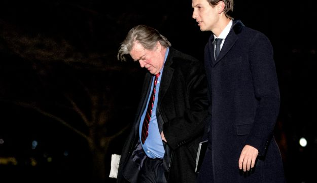FILE PHOTO: White House Senior Advisers Jared Kushner, right, and Steve Bannon, left, walk on the South Lawn of the White House in Washington, March 15, 2017.
