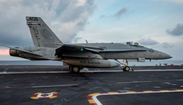 An F/A-18C Hornet from the Strike Fighter Squadron (VFA) launches from aircraft carrier USS Carl Vinson, in South China Sea April 8, 2017.