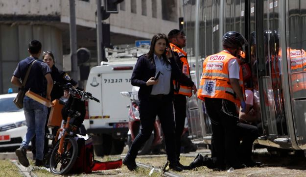 Emergency services and police are seen at the scene of an stabbing attack in Jerusalem, April 14, 2017.