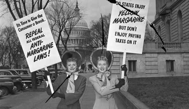 Mrs. Arthur Hebb, Jr., of Baltimore, Md., and Mrs. J.C. Alicoate of Miami, Fla., carry picket signs in connection with the hearing before the House Agriculture committee on proposed changes in the oleo, aka, margarine, laws, in Washington, D.C., March 3, 1949.