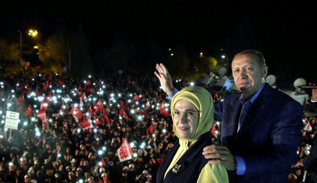 Turkish President Tayyip Erdogan, accompanied by his wife Emine Erdogan, addresses his supporters in Istanbul, Turkey, late April 16, 2017.