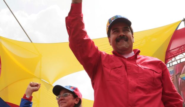 Venezuela's President Nicolas Maduro, right, waves to supporters next to his wife Cilia Flores during a rally in Caracas, Venezuela on April 19,