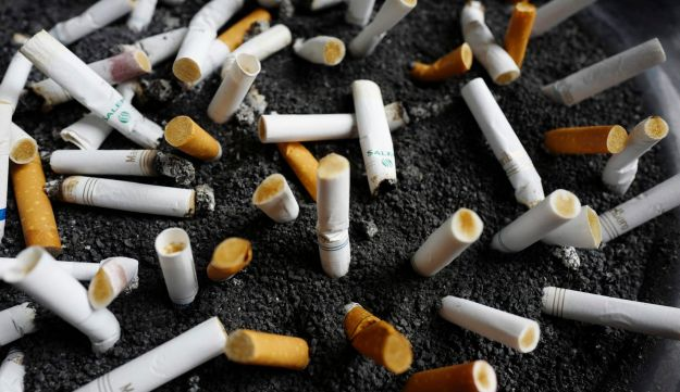 Discarded cigarette butts in an ashtray outside a New York office building.