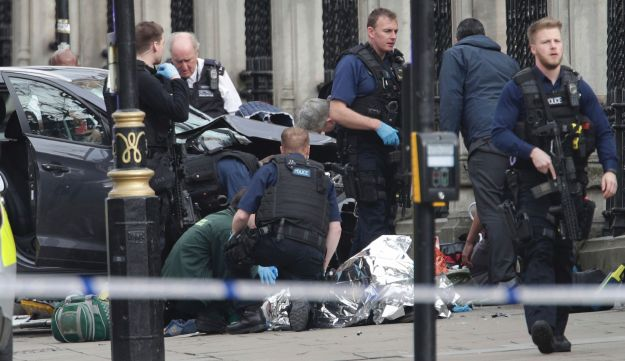Emergency personnel tend to an injured person close to the Palace of Westminster, London, Wednesday, March 22, 2017.