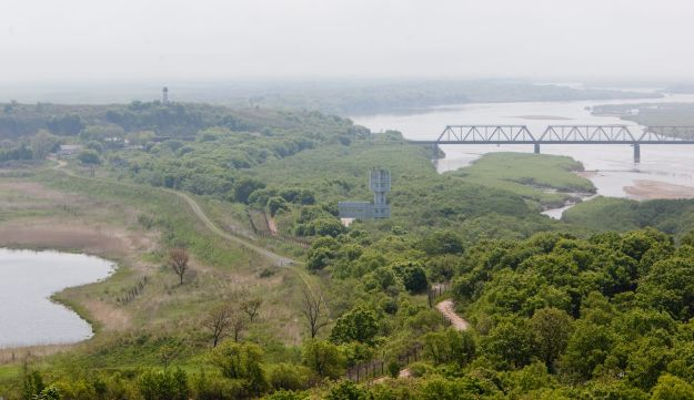 A view shows Russia, left, North Korea, right, and China, bottom, from Fangchuan, Jilin province, China, on Saturday, June 5, 2010.