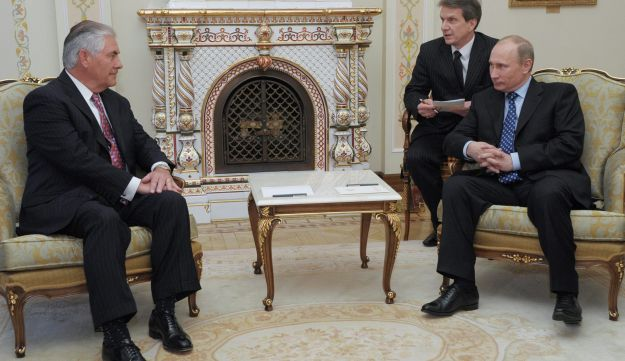 FILE PHOTO: Putin and ExxonMobil CEO Rex Tillerson attend a meeting at in 2012.