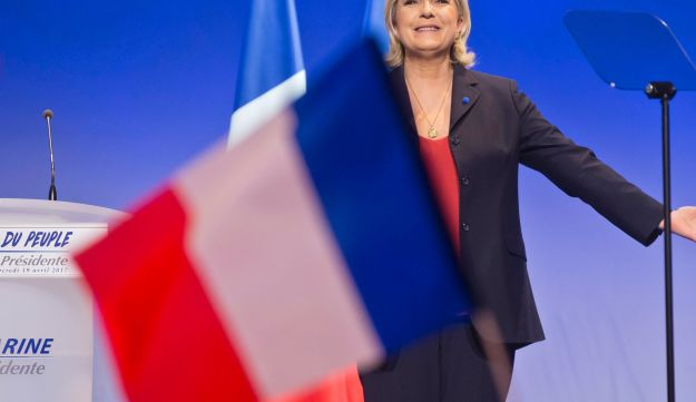Far-right leader Marine Le Pen arrives on stage in Marseille, southern France, Wednesday, April 19, 2017.
