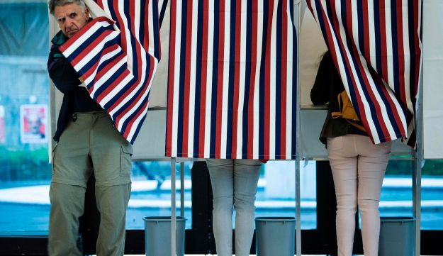 A French citizen leaves a voting booth after casting his ballot in France's presidential election at the Embassy of France in Washington, April 22, 2017.