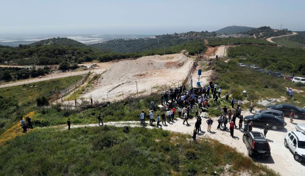 Lebanese and foreign journalists gather at a border point, during a media trip organized by Hezbollah at the Lebanese-Israeli border near the village of Labbouneh, south Lebanon, on April 20.