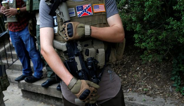 A member of a white supremacists militia stands near a rally in Charlottesville, Virginia, U.S., August 12, 2017.   REUTERS/Joshua Roberts