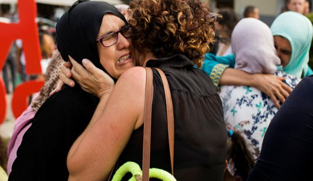 Families of young men believed responsible for the attacks in Barcelona and Cambrils gather along with members of the Muslim community to denounce terrorism in Ripoll, north of Barcelona, Aug. 19, 2017.