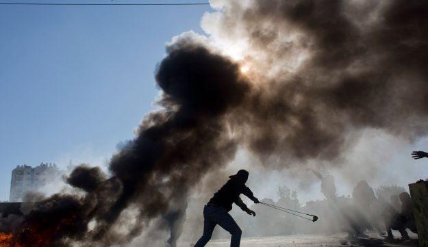 Palestinian protesters in the West Bank city of Ramallah, Friday, Dec. 8, 2017