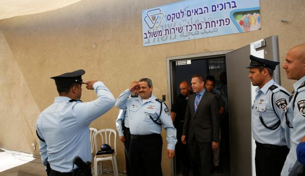 Police Commissioner Roni Alsheich, second from left, and Public Security Minister Gilad Erdan, in suit, at the dedication of the station, or Integrated Service Center, at Shoafat, May 7, 2017.