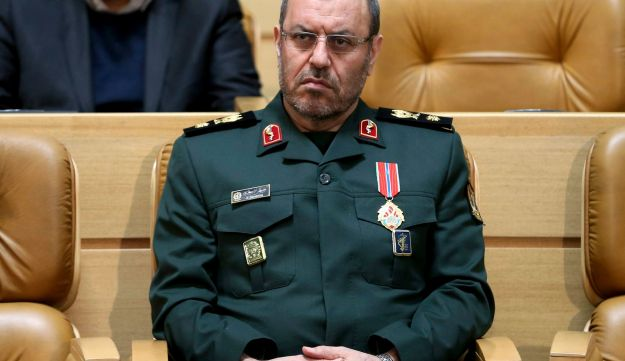 """On Feb. 8, 2016, Iranian Defense Minister Hossein Dehghan sits after being awarded the """"Medal of Courage"""" by President Hassan Rouhani during a ceremony in Tehran, Iran."""