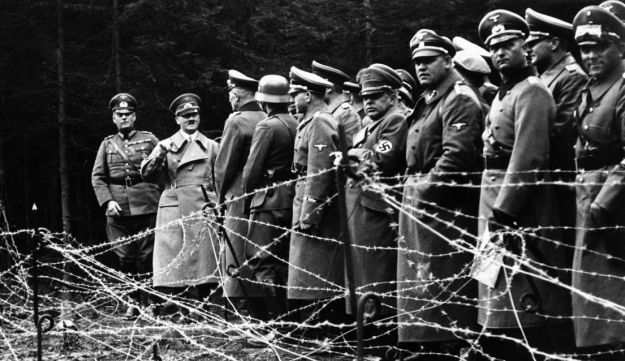 Hitler with other Nazis following the conquest of Sudetenland in 1938.